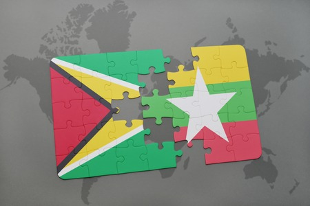 puzzle with the national flag of guyana and myanmar on a world map background. 3D illustration