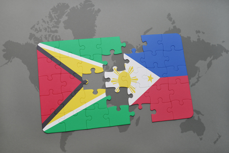 manila: puzzle with the national flag of guyana and philippines on a world map background. 3D illustration