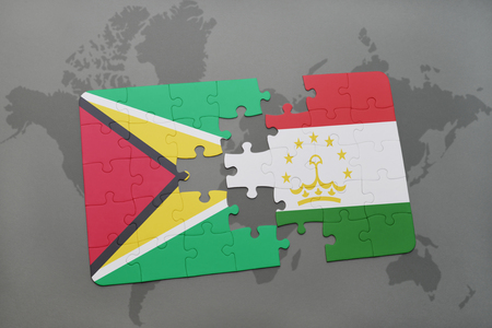 economy of tajikistan: puzzle with the national flag of guyana and tajikistan on a world map background. 3D illustration Stock Photo