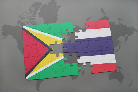 puzzle with the national flag of guyana and thailand on a world map background. 3D illustration