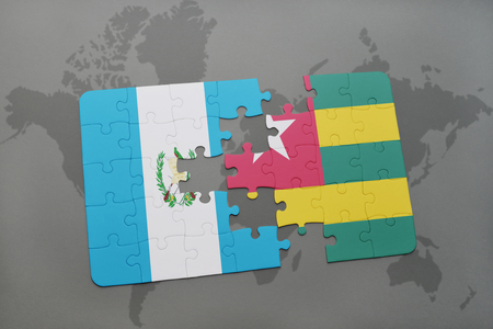 puzzle with the national flag of guatemala and togo on a world map background. 3D illustration