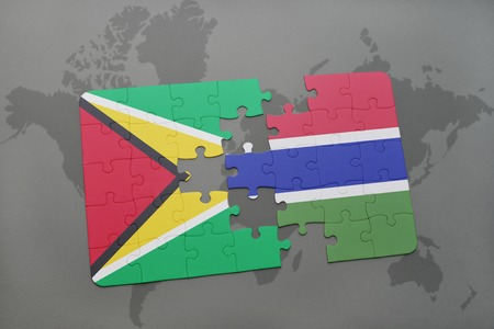 puzzle with the national flag of guyana and gambia on a world map background. 3D illustration Stock Photo