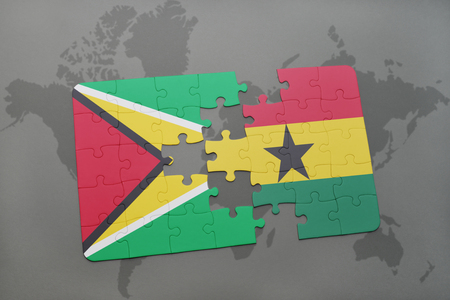 guyanese: puzzle with the national flag of guyana and ghana on a world map background. 3D illustration