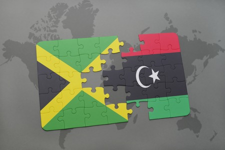 puzzle with the national flag of jamaica and libya on a world map background. 3D illustration Stock Photo