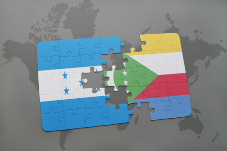 puzzle with the national flag of honduras and comoros on a world map background. 3D illustration Stock Photo