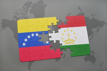 puzzle with the national flag of venezuela and tajikistan on a world map background. 3D illustration Stock Photo