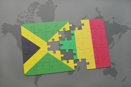 puzzle with the national flag of jamaica and mali on a world map background. 3D illustration Stock Photo