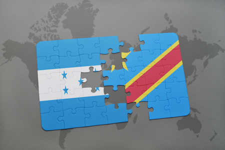 grey background texture: puzzle with the national flag of honduras and democratic republic of the congo on a world map background. 3D illustration Stock Photo
