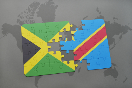 grey background texture: puzzle with the national flag of jamaica and democratic republic of the congo on a world map background. 3D illustration