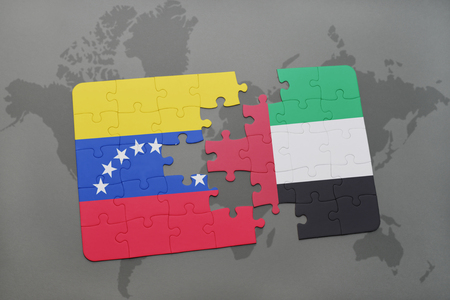 grey background texture: puzzle with the national flag of venezuela and united arab emirates on a world map background. 3D illustration