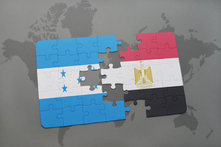 puzzle with the national flag of honduras and egypt on a world map background. 3D illustration