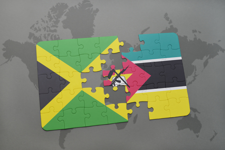 grey background texture: puzzle with the national flag of jamaica and mozambique on a world map background. 3D illustration