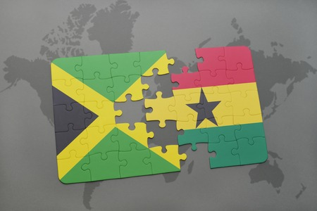puzzle with the national flag of jamaica and ghana on a world map background. 3D illustration