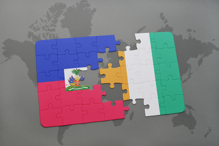 puzzle with the national flag of haiti and cote divoire on a world map background. 3D illustration