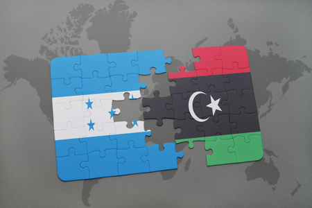 puzzle with the national flag of honduras and libya on a world map background. 3D illustration