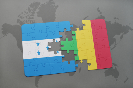 puzzle with the national flag of honduras and mali on a world map background. 3D illustration