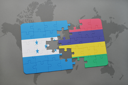 grey background texture: puzzle with the national flag of honduras and mauritius on a world map background. 3D illustration