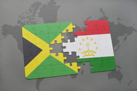 economy of tajikistan: puzzle with the national flag of jamaica and tajikistan on a world map background. 3D illustration Stock Photo