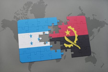 puzzle with the national flag of honduras and angola on a world map background. 3D illustration