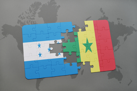 puzzle with the national flag of honduras and senegal on a world map background. 3D illustration