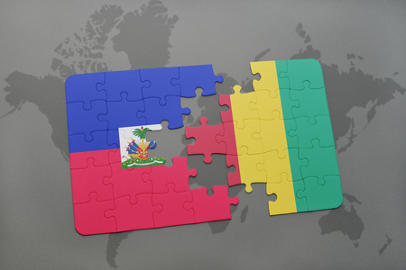 puzzle with the national flag of haiti and guinea on a world map background. 3D illustration