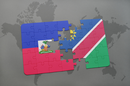 puzzle with the national flag of haiti and namibia on a world map background. 3D illustration