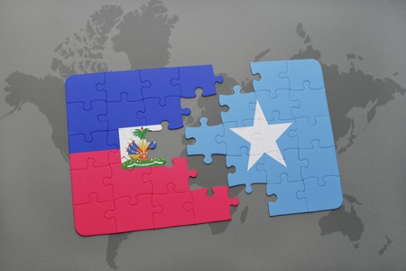 Puzzle with the national flag of haiti and uganda on a world stock puzzle with the national flag of haiti and somalia on a world map background 3d gumiabroncs