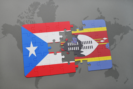 puzzle with the national flag of puerto rico and swaziland on a world map background. 3D illustration