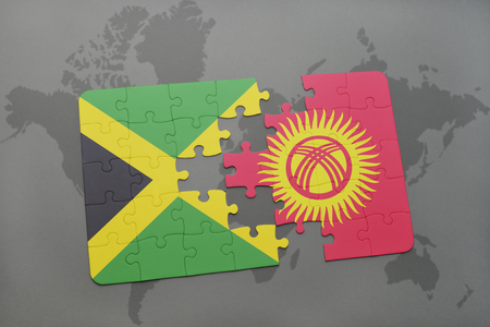 puzzle with the national flag of jamaica and kyrgyzstan on a world map background. 3D illustration