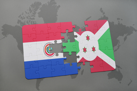 puzzle with the national flag of paraguay and burundi on a world map background. 3D illustration Stock Photo