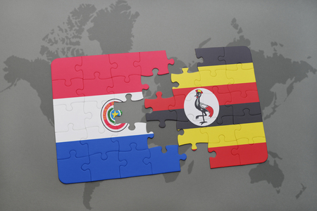 puzzle with the national flag of paraguay and uganda on a world map background. 3D illustration