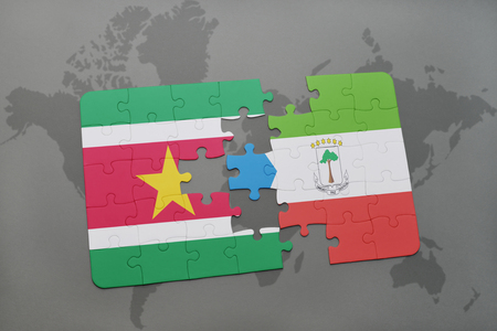 puzzle with the national flag of suriname and equatorial guinea on a world map background. 3D illustration