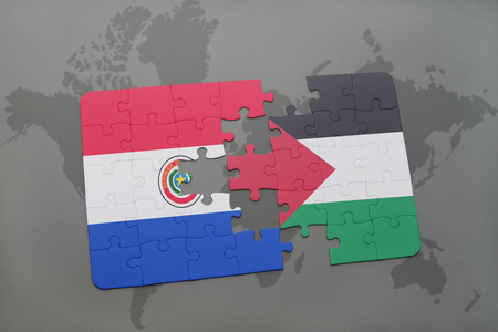 puzzle with the national flag of paraguay and palestine on a world map background. 3D illustration Stock Photo