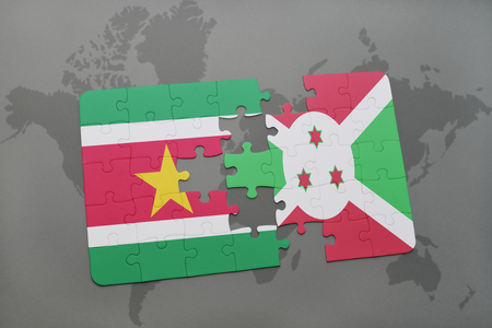 puzzle with the national flag of suriname and burundi on a world map background. 3D illustration Stock Photo