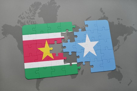 puzzle with the national flag of suriname and somalia on a world map background. 3D illustration