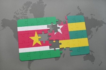 puzzle with the national flag of suriname and togo on a world map background. 3D illustration