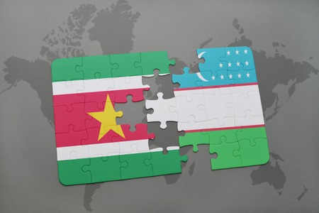 puzzle with the national flag of suriname and uzbekistan on a world map background. 3D illustration