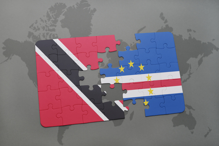 praia: puzzle with the national flag of trinidad and tobago and cape verde on a world map background. 3D illustration