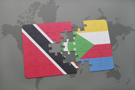 puzzle with the national flag of trinidad and tobago and comoros on a world map background. 3D illustration Stock Photo