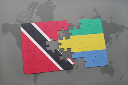 puzzle with the national flag of trinidad and tobago and gabon on a world map background. 3D illustration Stock Photo