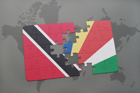 puzzle with the national flag of trinidad and tobago and seychelles on a world map background. 3D illustration