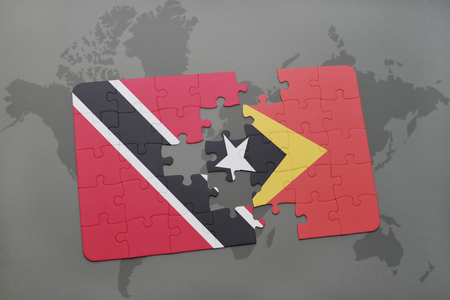 timor: puzzle with the national flag of trinidad and tobago and east timor on a world map background. 3D illustration Stock Photo