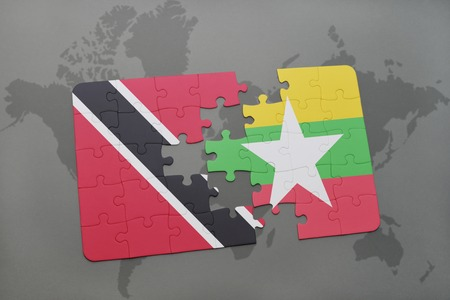 puzzle with the national flag of trinidad and tobago and myanmar on a world map background. 3D illustration