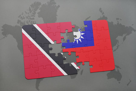 puzzle with the national flag of trinidad and tobago and taiwan on a world map background. 3D illustration Stock Photo