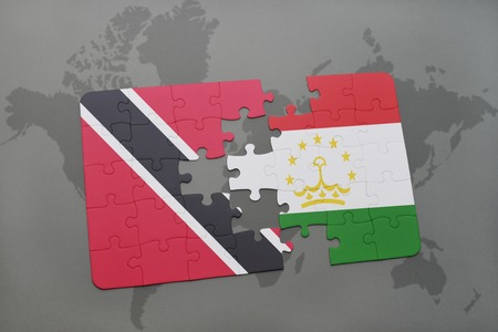 puzzle with the national flag of trinidad and tobago and tajikistan on a world map background. 3D illustration