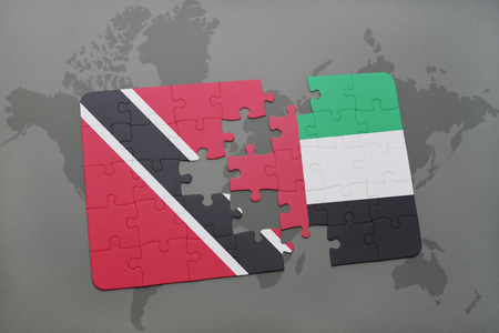 puzzle with the national flag of trinidad and tobago and united arab emirates on a world map background. 3D illustration