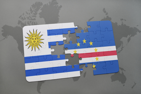 puzzle with the national flag of uruguay and cape verde on a world map background. 3D illustration