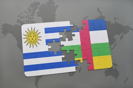 puzzle with the national flag of uruguay and central african republic on a world map background. 3D illustration