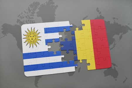 puzzle with the national flag of uruguay and chad on a world map background. 3D illustration
