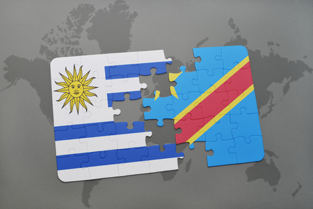 puzzle with the national flag of uruguay and democratic republic of the congo on a world map background. 3D illustration Stock Photo